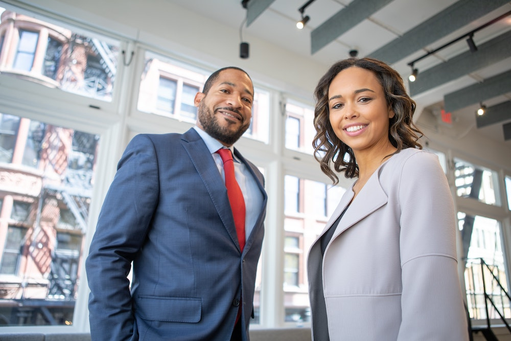 Man and Woman in Business Attire
