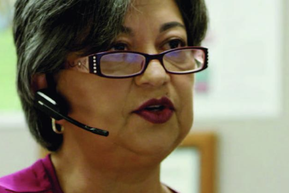 woman wearing a headset at a call center